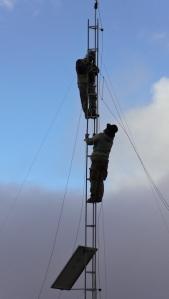 IQF volunteer Matthew Mueller with technician installing tower